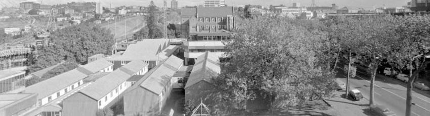 Black and white image of old buildings on campus