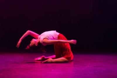 Dancers performing under fluro lighting.