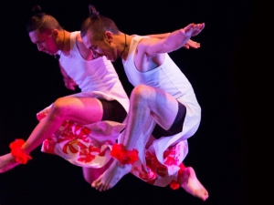 Two male dancers leaping.