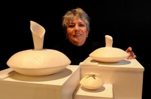 Image of Colleen Urlich with some of her work.