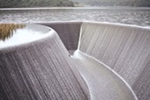 Image of water rushing into Huia Dam spillway.