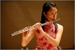 Melody Lin playing the flute.